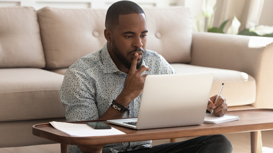 Young african american guy studying on online courses.